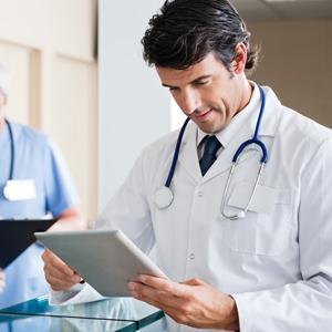 mid_adult_male_doctor_holding_digital_tablet300